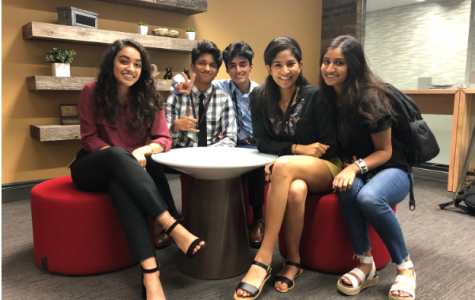Sivani Sayani (left) and Sunny Shaheen (third from left) collaborate with other interns while developing the framework for the CSHS.