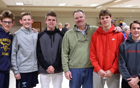 Tom Schniedwind, head coach of the boys varsity and junior varsity lacrosse teams poses with future BNL players.