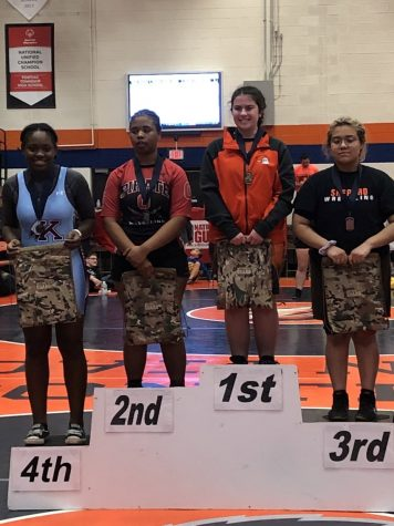 Wrestling team adds female competitors to roster