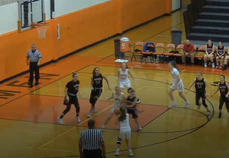 White loads a three-pointer in her senior night game versus Bradley-Bourbonnais