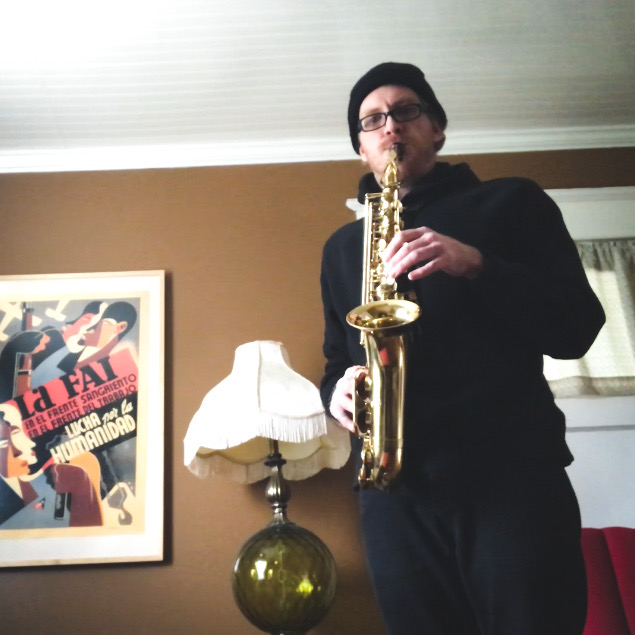 Mr. Stefen Robinson plays the saxophone during the COVID-19