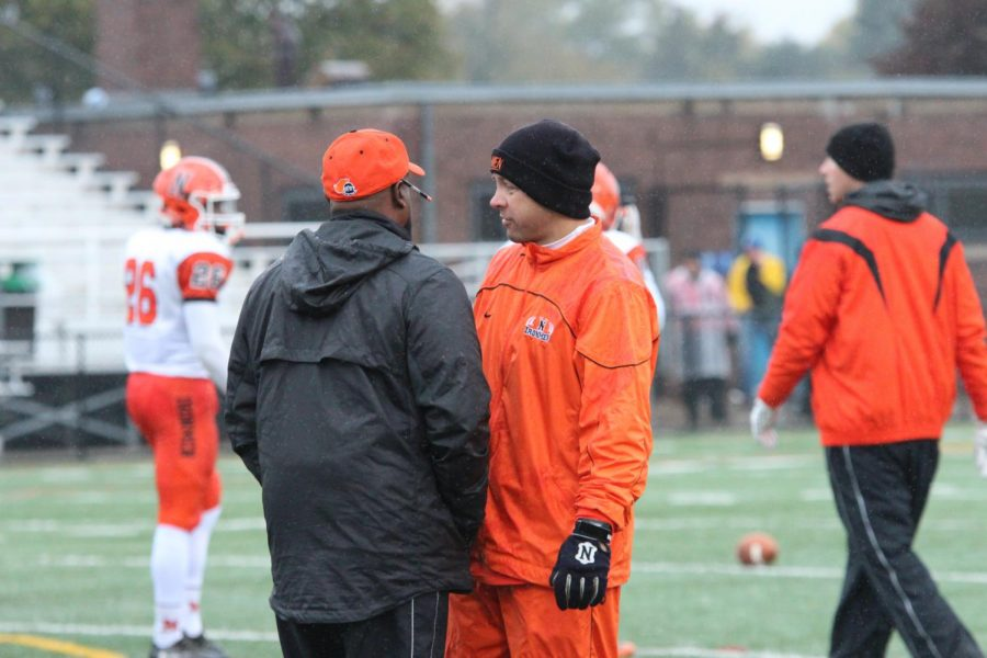 Mr. Wes Temples confers with Mr. Bryan Thomas before his final game as head coach against Mt. Carmel High school on Nov. 14, 2017. Temples most successful season as a head coach came with an appearance in the State Quarterfinals in 2015.