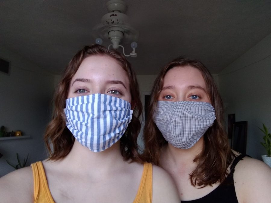 Kennedy (left) and Piper (right) Coe model two different patterned masks they sewed.