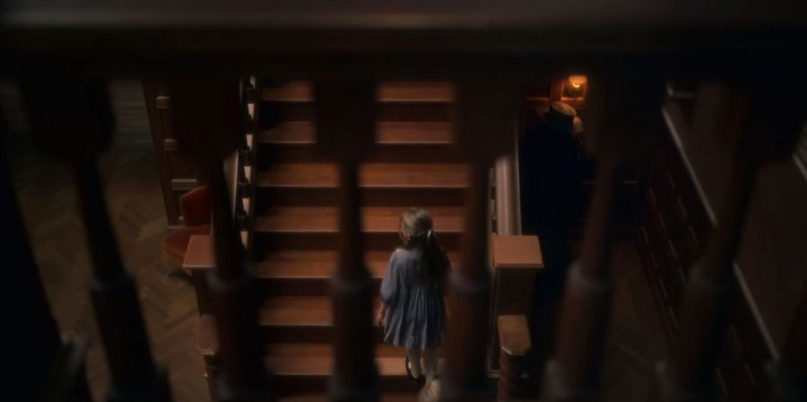 During one of the first scenes at Bly, the plague doctor can be seen chilling beside the stairs.