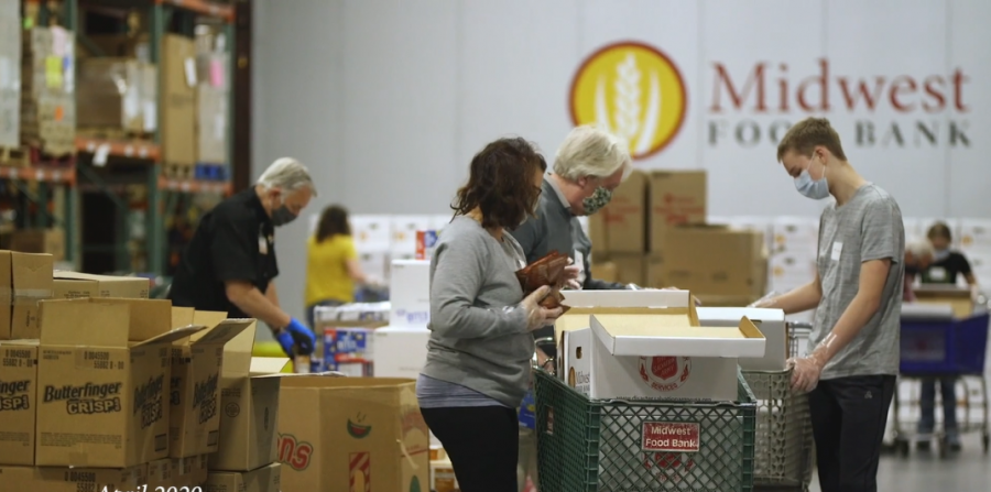 Volunteers fill boxes of food at Midwest Food Bank in Normal. Increased unemployment caused by COVID-19 meant that the packing and distribution of food was essential.