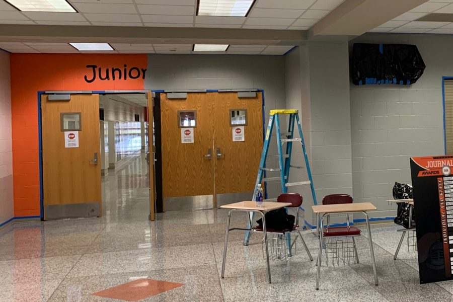 Signage+will+be+added+around+the+building+to+replace+outdated+design+like+the+orange+and+black+entrance+to+the+junior+hallway.