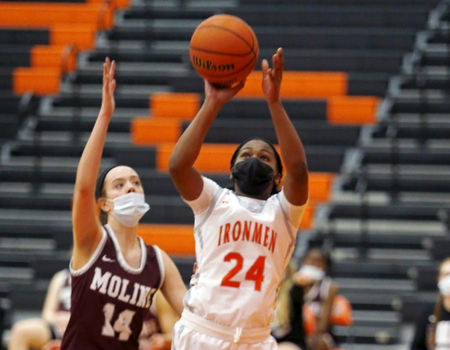 Briana Mathews, who scored eight points against Moline, pulled up for a jumper under the hoop.
